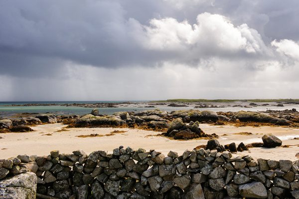 Stone wall on beach Carna