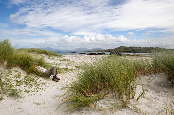 Sunbather on east end beach Inishbofin